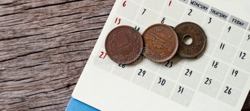 Yen notes and yen coins. With calendar in save money concept royalty free stock photos
