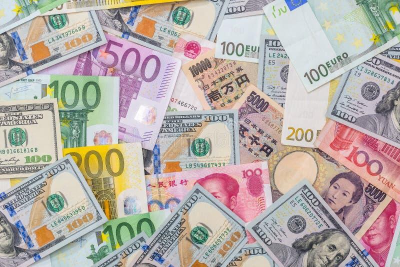 Yenes japoneses, dólar de EE. UU., yuan chino, euro foto de archivo