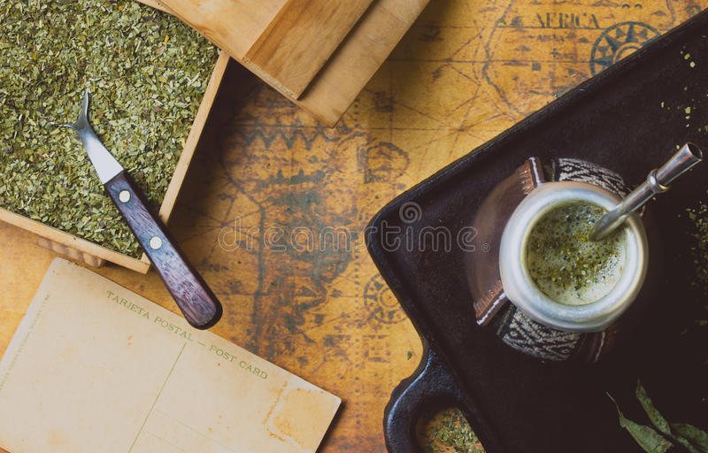 Yerba herb mate on antique map. Top View. Vintage background royalty free stock image
