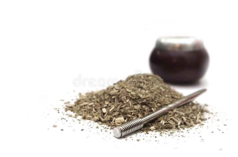 Yerba Mate. Calabash and bombilla with yerba mate isolated on white royalty free stock photos