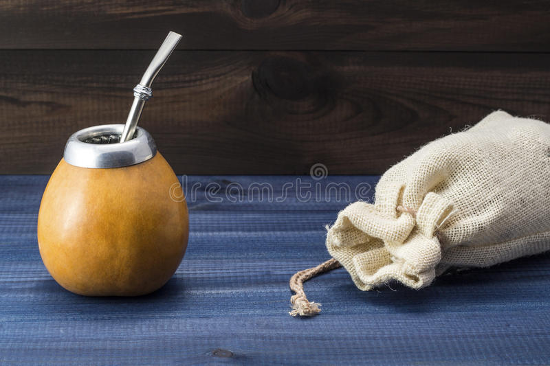 Yerba mate with gourd matero, bombilla and linen bag. Yerba mate with gourd matero and bombilla. image with copy space royalty free stock photography