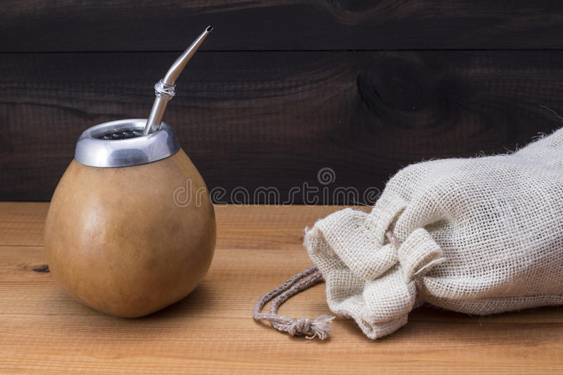 Yerba mate with gourd matero, bombilla and linen bag. Yerba mate with gourd matero and bombilla. image with copy space stock photography
