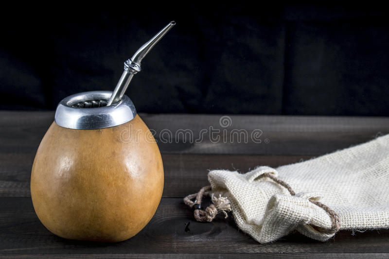Yerba mate with gourd matero, bombilla and linen bag. Yerba mate with gourd matero and bombilla. image with copy space royalty free stock photo