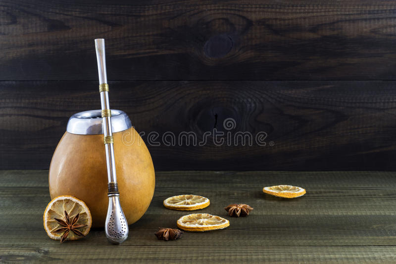 Yerba mate with lemon slices and anise in gourd matero. Image with copy space royalty free stock image
