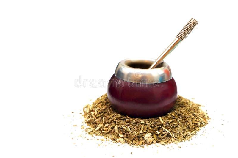 Yerba Mate tea. Calabash and bombilla with yerba mate isolated on white royalty free stock image