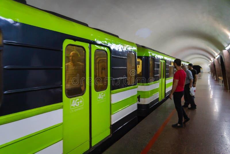 Yerevan Metro subway train platform and passengers , Armenia. royalty free stock photo
