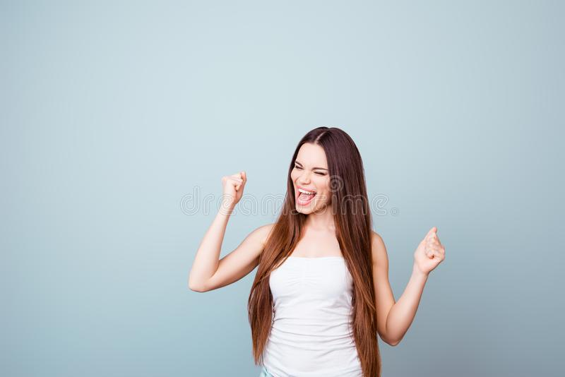 Yes! I did it! A dream of the young cute brunette lady came true royalty free stock photography