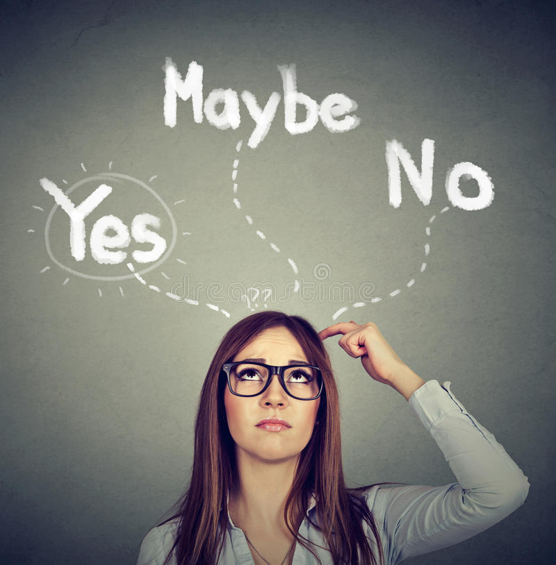 Yes Maybe or No? Thoughtful woman making a choice royalty free stock photography