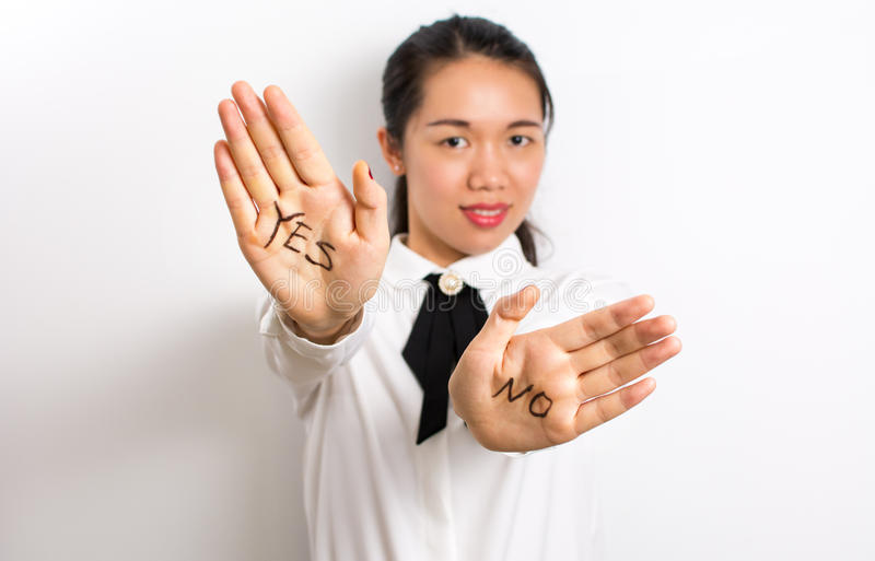 Yes or No? Words on businesswoman hands royalty free stock image