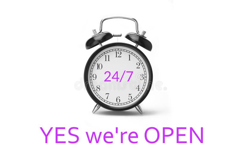 Yes we`re OPEN sign in magenta and white, on shop glass door stock image