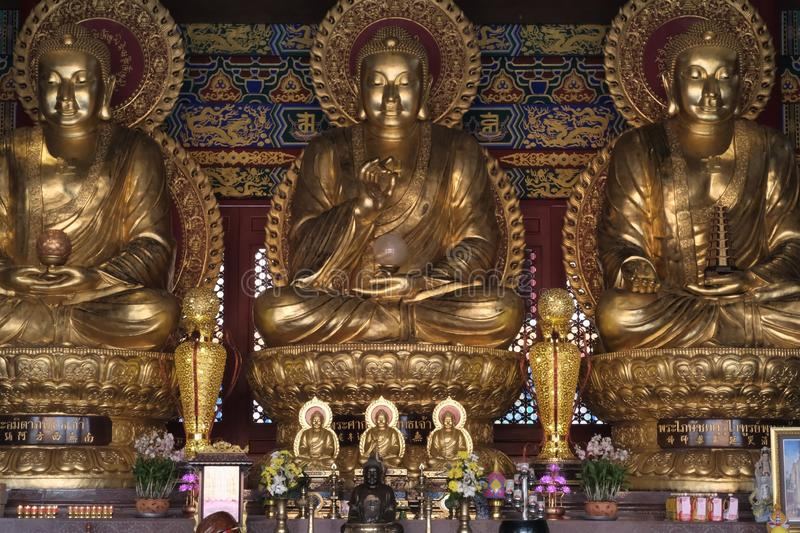 Three Giant Buddha Images in Chinese pattern style. Yesterday,I travel to visit the most beautiful Chinese temple in a province nearby the capital city of royalty free stock photography