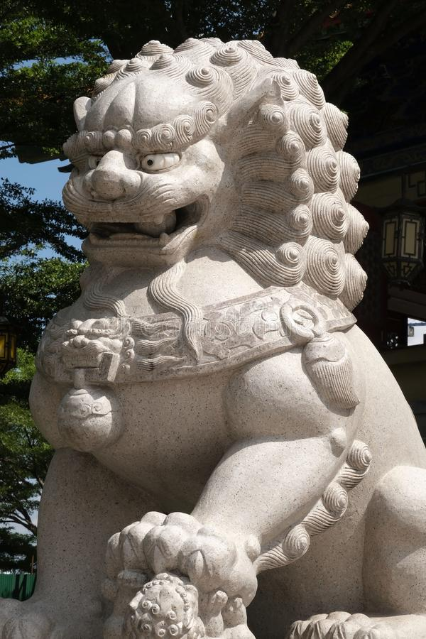 Full frame of a stone lion. Yesterday I went to a beautiful Chinese temple far away from home and take pictures royalty free stock images