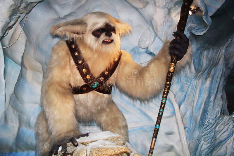 Yeti avec un bâton image stock