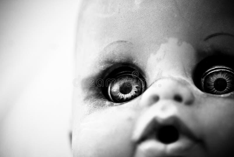 Yeux effrayants de poupée photos stock