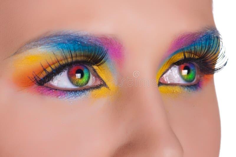 Yeux femelles multicolores. images stock