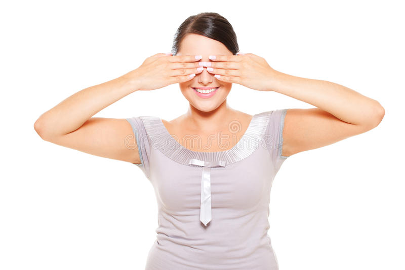 Yeux souriants attrayants de revêtement de femme photos stock
