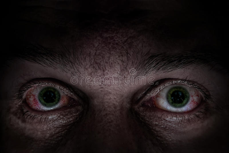 Yeux verts effrayants photo libre de droits