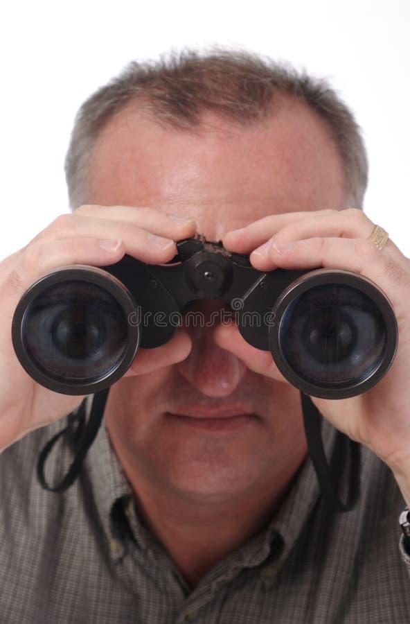 Yeux visibles dans des jumelles images stock