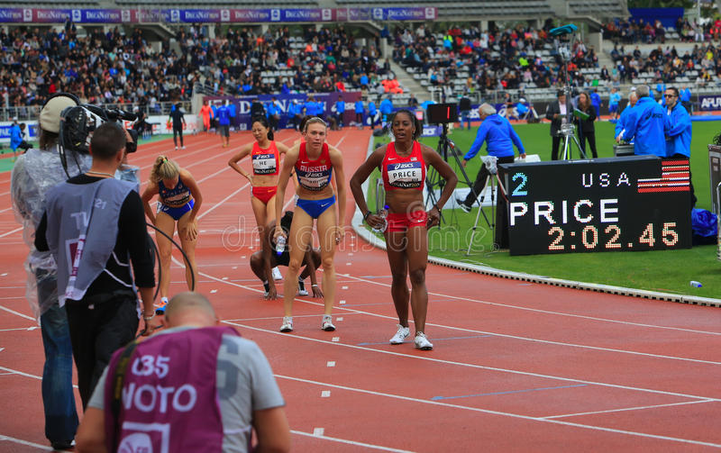 Yevgeniya Subbotina and Chanelle Price on the 800 meters race. Yevgeniya Subbotina, Chanelle Price and other athlets after the 800 meters race on DecaNation royalty free stock photography
