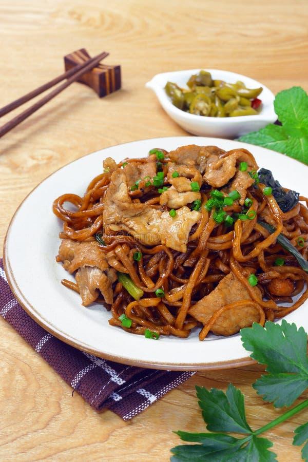 Yi mein noodle stir fried with dark caramel sauce stock photo