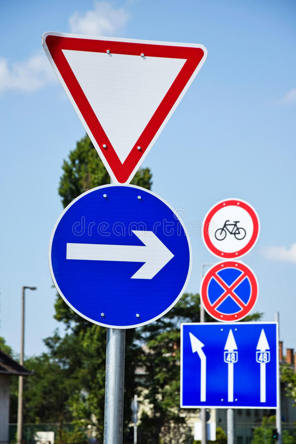 Yield and arrow traffic signs. At the road crossing royalty free stock photo