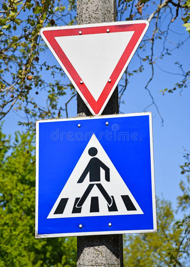 Yield and pedestrian traffic signs on a pole. Outdoors royalty free stock photography
