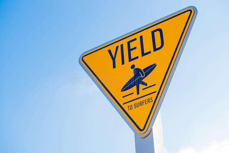 Yield to surfer sign in Southern California royalty free stock photography