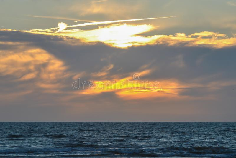 Yiew over the open ocean from evening Beach at Sunset Time royalty free stock images