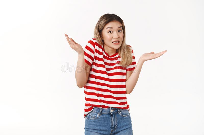Yikes sorry my fault. Awkward silly timid blond asian girl new team member apologizing making mistake oops raise hands royalty free stock photo