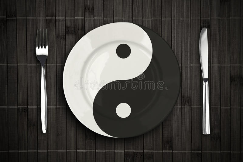 Download Yin Yan Plate Over Bamboo Placemat Concept Stock Photo - Image: 22310300