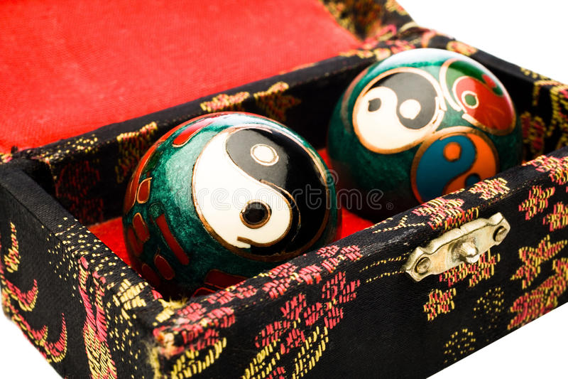 Yin Yang balls in box. Yin Yang balls in a box isolated over white stock photos