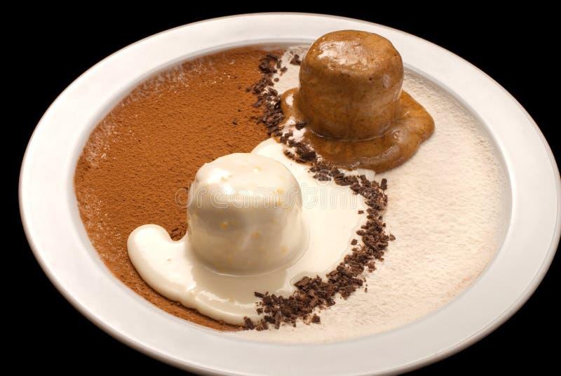 Yin Yang decoration of chocolate and vanilla ice cream. On a white plate, scoop, gelato, dairy, dessert, food, frozen, brown, closeup, sweet, icecream, dark royalty free stock photo