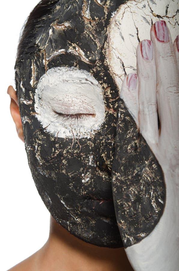 Yin-yang symbol on the face of asian woman. Makeup as a yin-yang on the face asian women stock photography