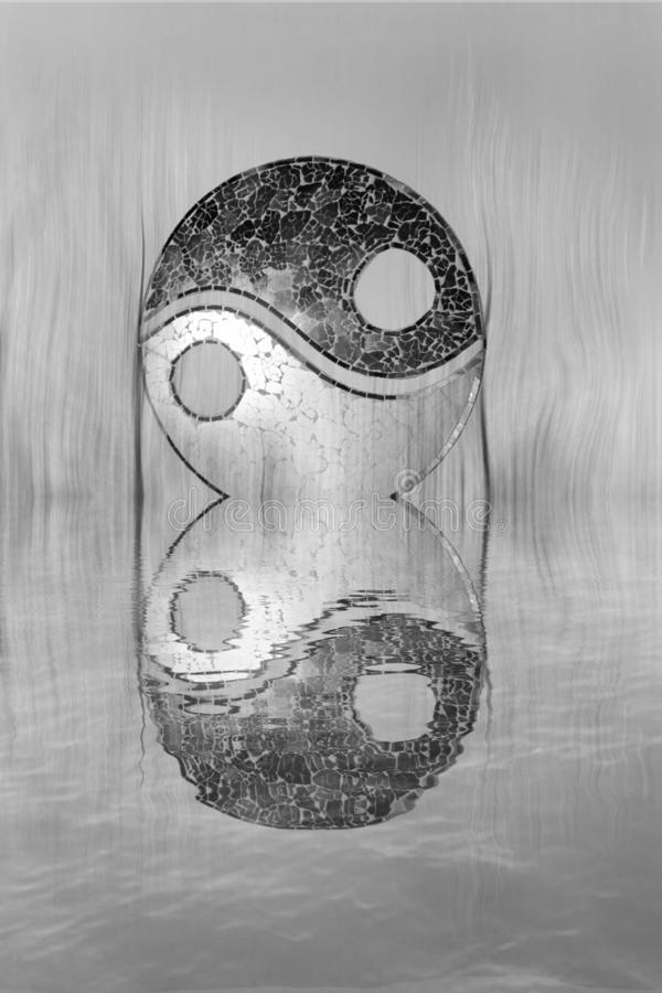 Yin-yang symbol in the forest in lake reflection. Zen, spiritual, meditayion, tao, budha, peace, relax, sikence, dark, balance, universlaw, black, white, grey royalty free stock photo
