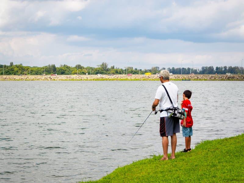 YISHUN NATURE PARK, SINGAPORE – 25 DEC 2019 – Father and son fishing at Yishun Nature Park, near Yishun dam, part of the. YISHUN NATURE PARK stock images