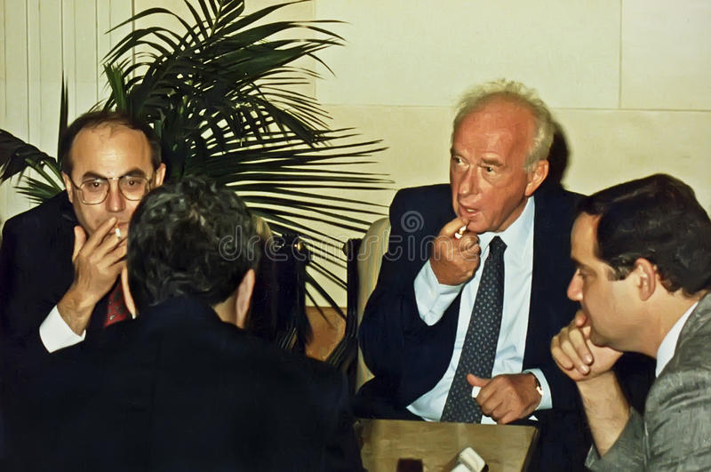 Yitzhak Rabin. Photographed with his aides, applying breath spray at the King David Hotel in Jerusalem, Israel, on June 17, 1992. He was preparing to meet with stock photo