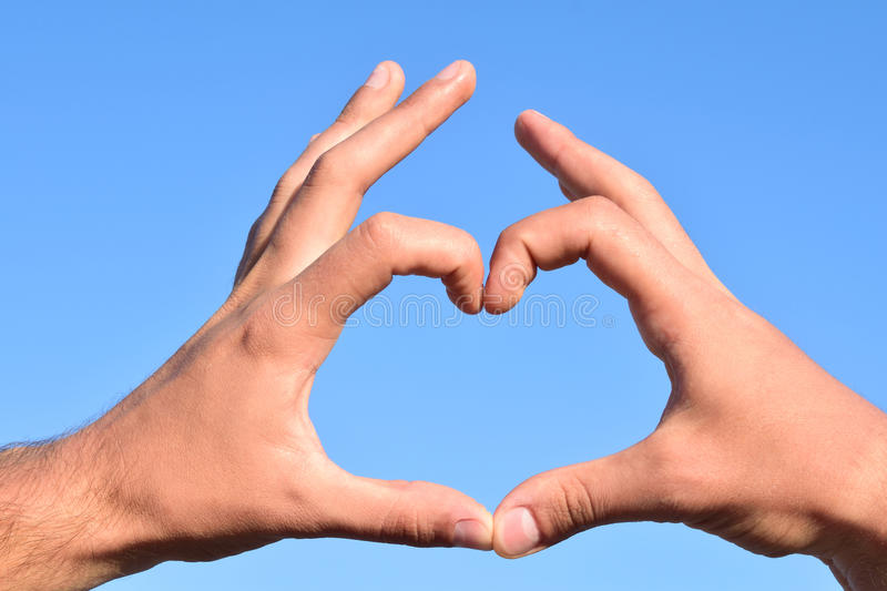 Symbol of heart shape. Heart Symbol Made with Two Hands stock images