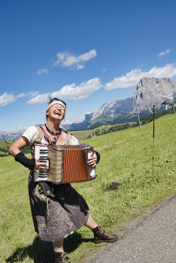 Free Yodeling In Alps - Musician Singing And Playing Accordion Royalty Free Stock Photography - 98151737