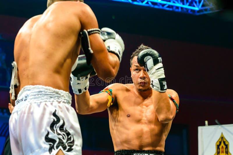 Yodsanklai Fairtex of Thailand and Kazbek Zubayraer of Rassia in Thai Fight Extreme 2013 royalty free stock photography