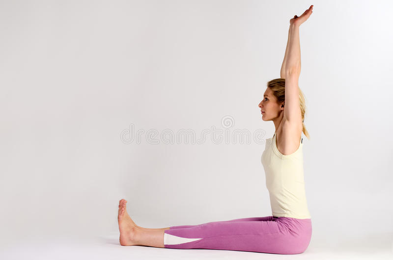 Yoga arms high up stock images