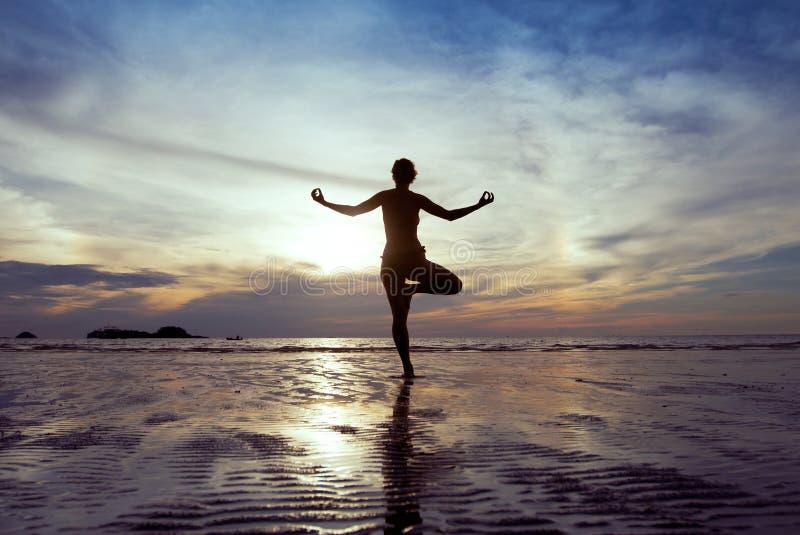 Yoga on the beach royalty free stock photos