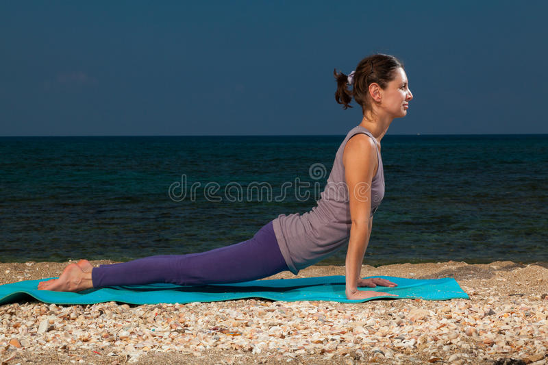 Yoga on the beach royalty free stock photography