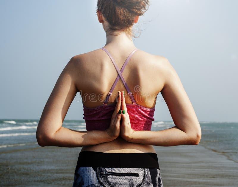 Yoga Beach Summer Mental Fitness Peace Pose Concept. Woman Yoga Beach Summer Mental Fitness Peace Pose stock image