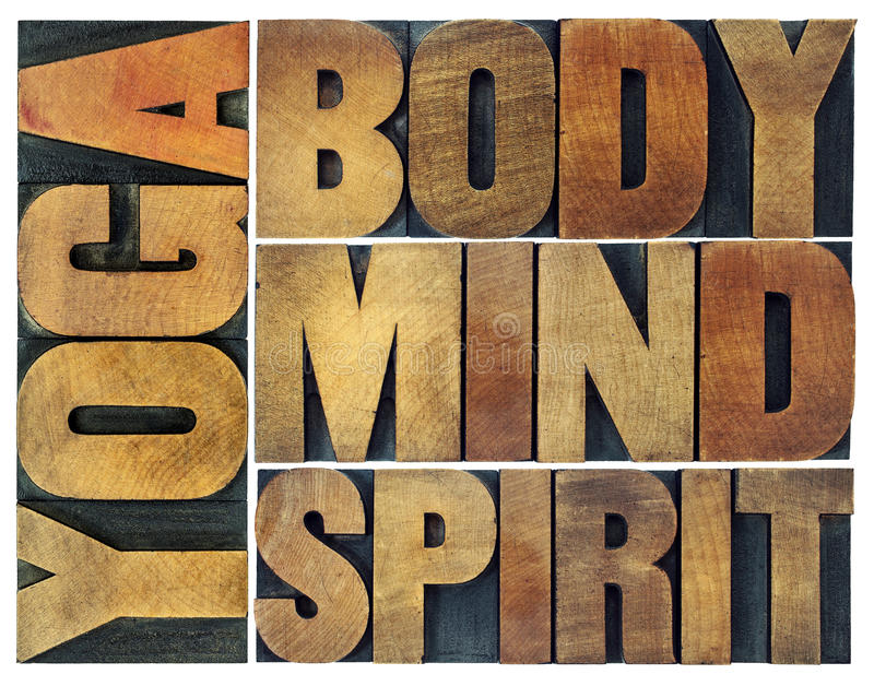Yoga, body, mind, soul and spirit word abstract. A collage of isolated text in vintage wood letterpress printing blocks with ink patina royalty free stock image
