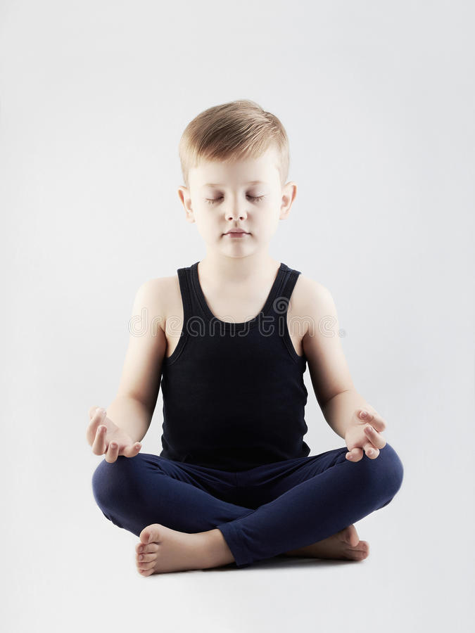 Yoga boy.child in the lotus position.children meditation and relaxation royalty free stock image