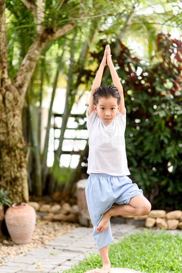 Yoga boy. Young Thai boy practicing yoga in the park.Easy Pose stock images