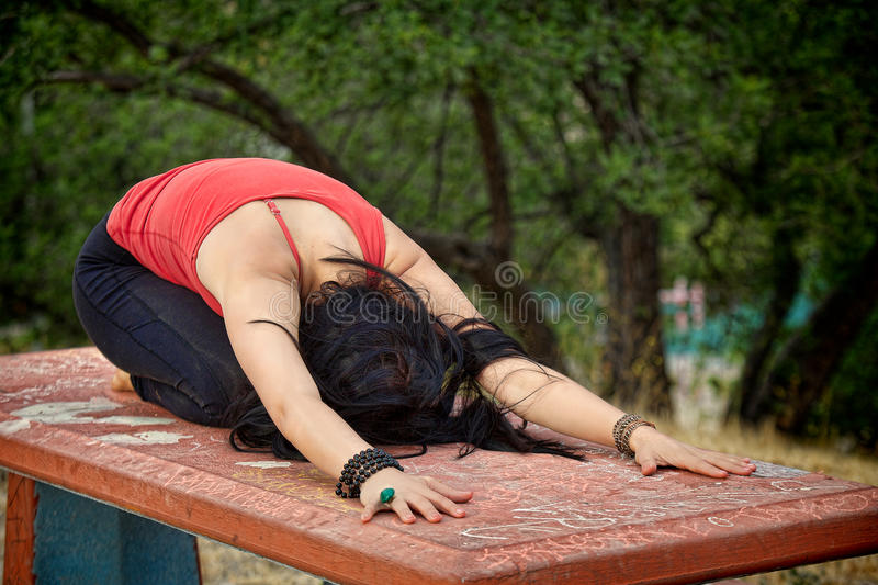 Yoga Child's Pose on Table royalty free stock image