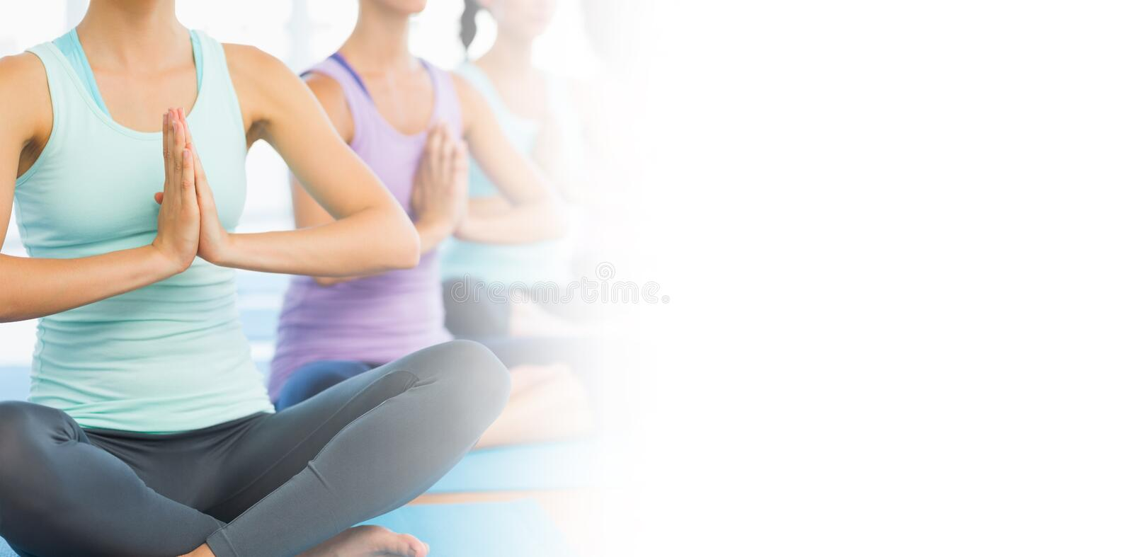 Yoga class in gym royalty free stock photography