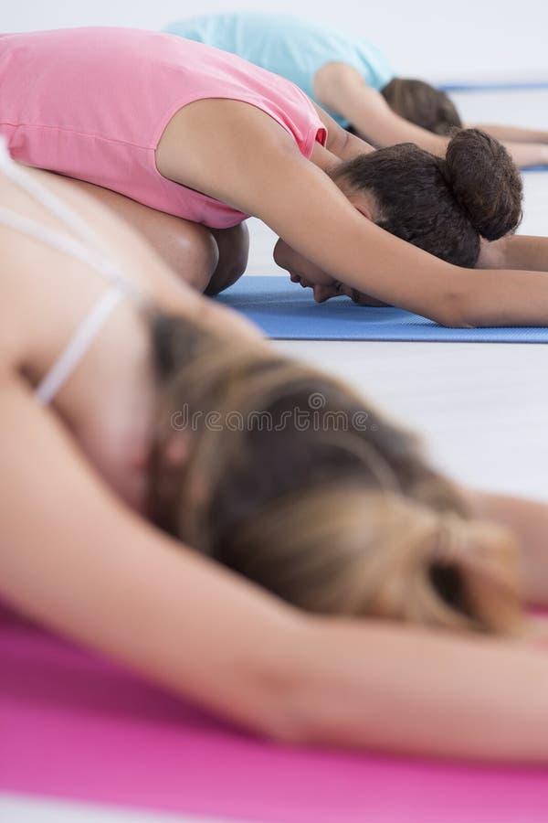 Stretching in shishuasana pose stock photography