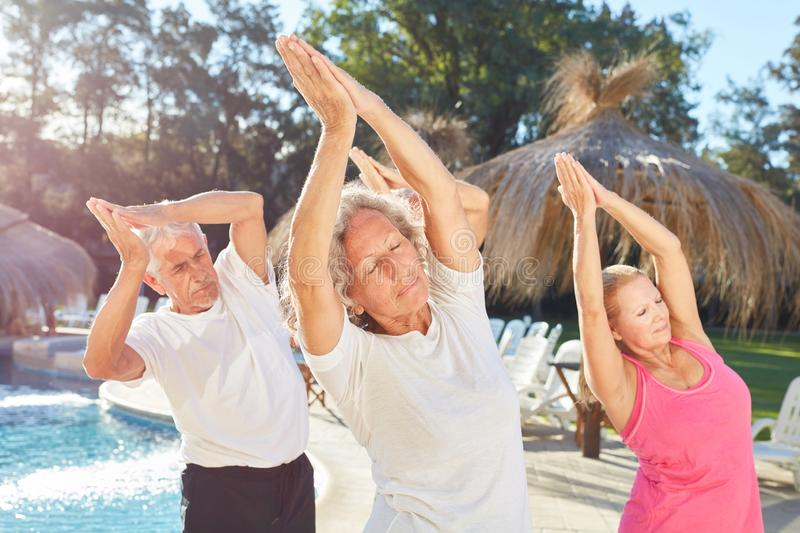 Yoga class for seniors makes exercise for fitness and health. In the spa hotel royalty free stock photo